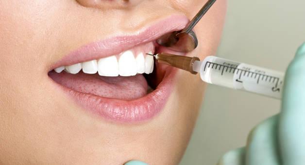 Чи боляче видаляти корінний зуб