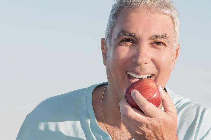 як звикнути до знімних зубних протезів
