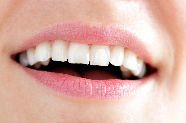 скільки приблизно коштує наростити зламаний зуб